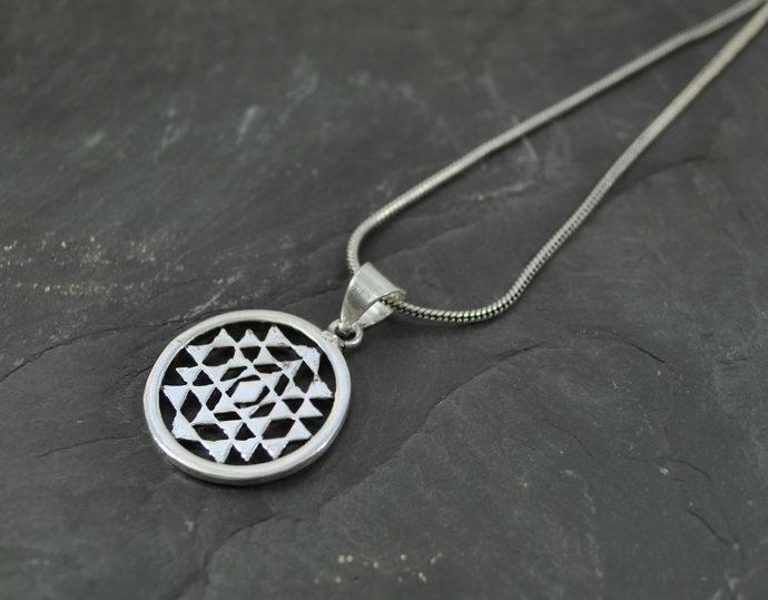 small silver yantra pendant